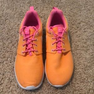Orange and pink Nike Roches